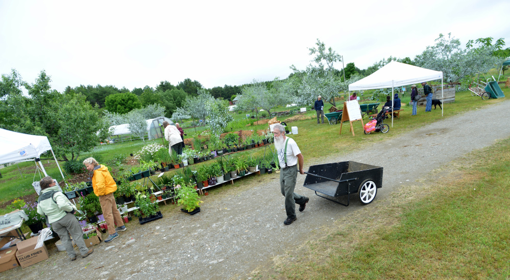 People browse among the demonstrations and products on display Saturday at the annual Maine Organic Farmers and Gardeners Association farm and homestead day workshops in Unity.