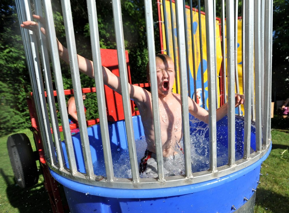 Dana Paradis, 12, gasps for air after being dunked in the dunk tank during the 7th Annual North End Night on Drummond Avenue in Waterville on June 27, 2014. The 10th edition of North End Night will be held Wednesday in Dave Quirion Park on Drummond Avenue.