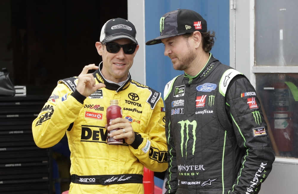 Matt Kenseth, left, talks with Kurt Busch before a practice session Saturday in Brooklyn, Michigan.