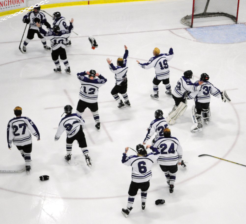 The Waterville hockey team celebrates after it won the 2015-16 Class B state championship at the Androscoggin Bank Colisse in Lewiston.