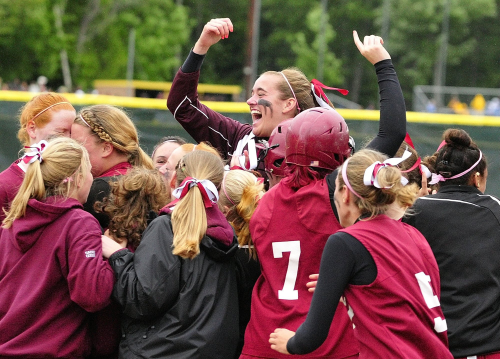 Richmond's Jamie Plummer leaps above her Bobcat teammates as they celebrate their 3-2 victory over Buckfield in the 2011 Western Class D championship game at St. Joseph's College in Standish.