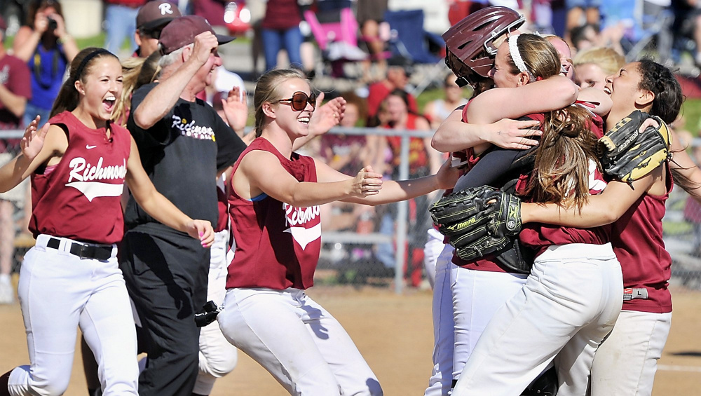 On Saturday, June 15,  2013, Richmond players celebrate the win with catcher, Chika Obi and pitcher, Jamie Plummer, starting it with a hug as the Richmond Bobcats and the Penobscot Valley Howlers played in the final for the Class D State Softball Championship at St. Joseph's College in Standish.