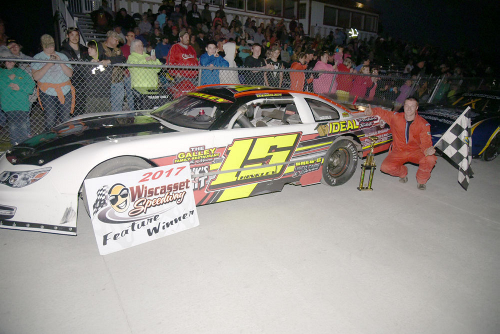Nick Hinkley of Wiscasset poses by Victory Lane after winning a Late Model race June 10 at Wiscasset Speedway.