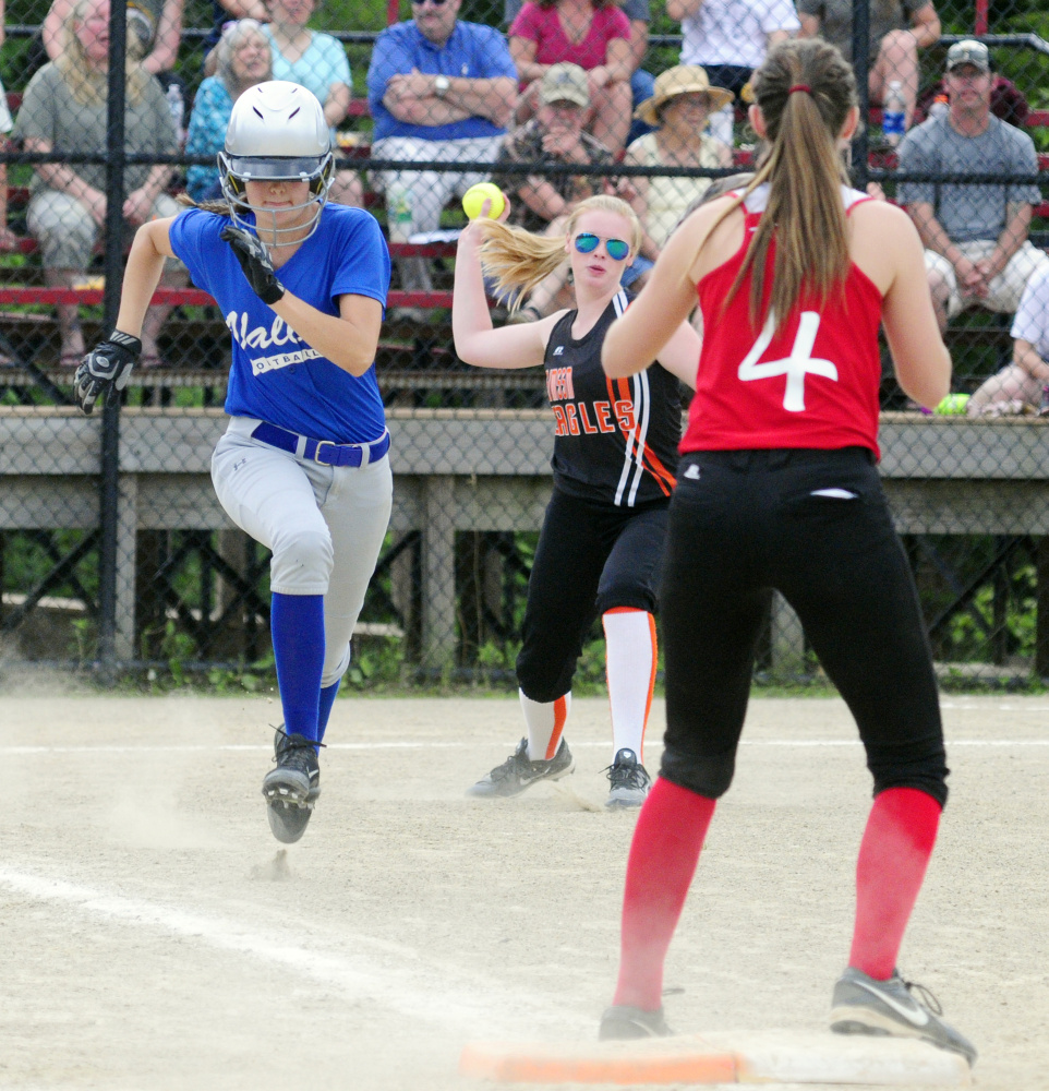 After laying down a bunt, Valley's Michaela Marden, left, sprints to first during the Class C/D senior all star game Thursday in Augusta. She beat the throw from Limestone pitcher Delaney Rossignol, center, to Central first baseman Emma Campbell.