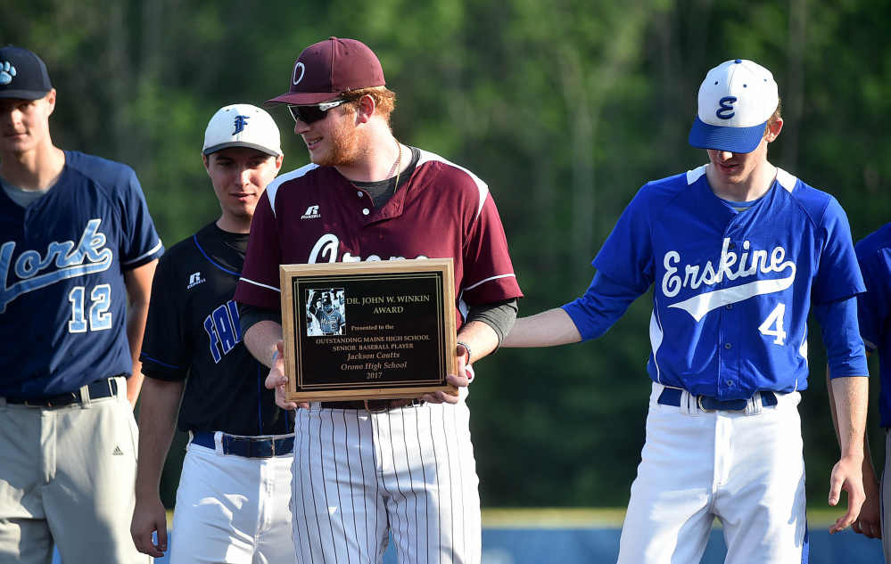 Orono's Jackson Coutts holds the Dr. John Winkin Award after receiving it following the Class C and D All-Star game Friday at Colby College in Waterville.