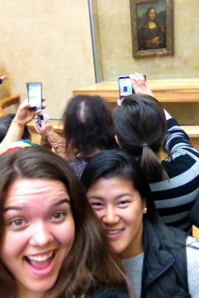 Emily Higginbotham, left, takes a selfie with friend Hannah O'Neill at the Louvre Museum in France with the