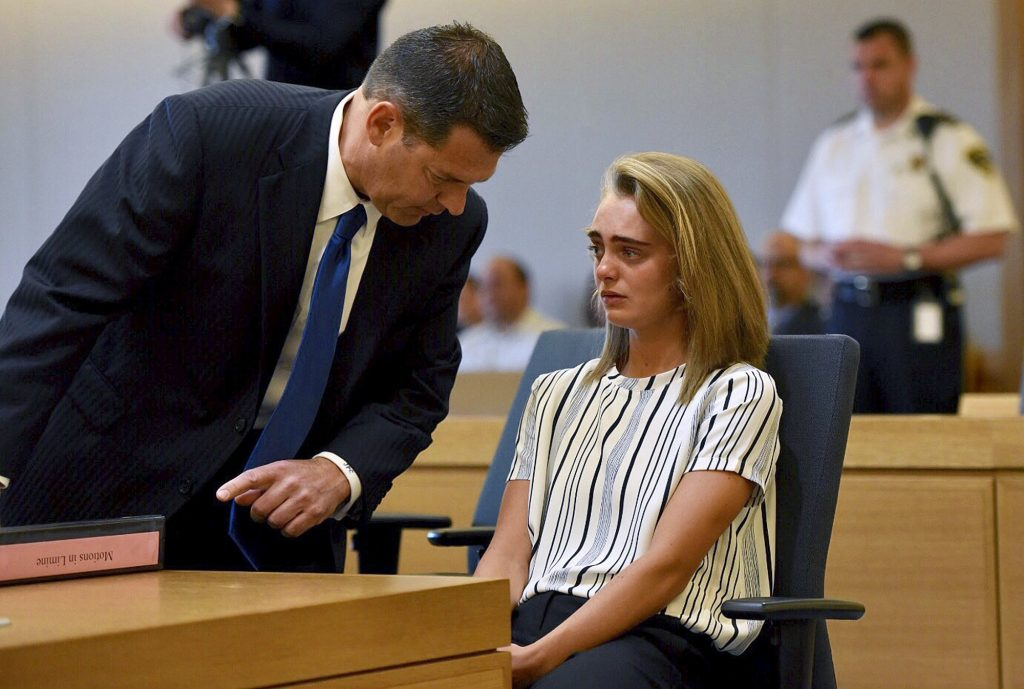 Attorney Joseph Cataldo talks to his client, Michelle Carter, at Taunton Juvenile Court in Taunton, Mass., on Monday. Carter is charged with manslaughter for sending her boyfriend text messages encouraging him to kill himself.