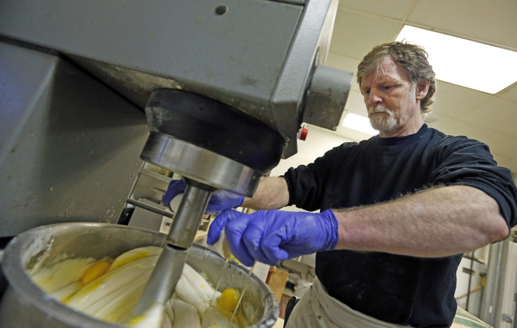 Masterpiece Cakeshop owner Jack Phillips cracks eggs into a mixer in his store in Lakewood, Colo., in this 2014 photo. Supreme Court justices will consider whether he  can refuse to make a wedding cake for a gay couple.