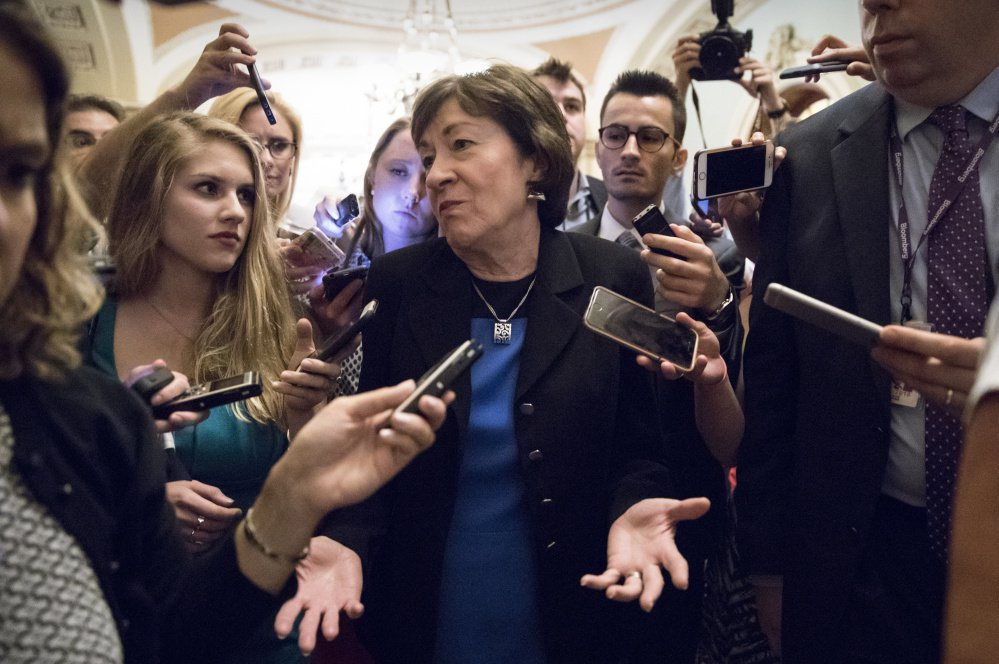 Sen. Susan Collins, R-Maine, is surrounded by reporters on Capitol Hill on Thursday after a revised version of the Republican health care bill was announced by Senate Majority Leader Mitch McConnell.