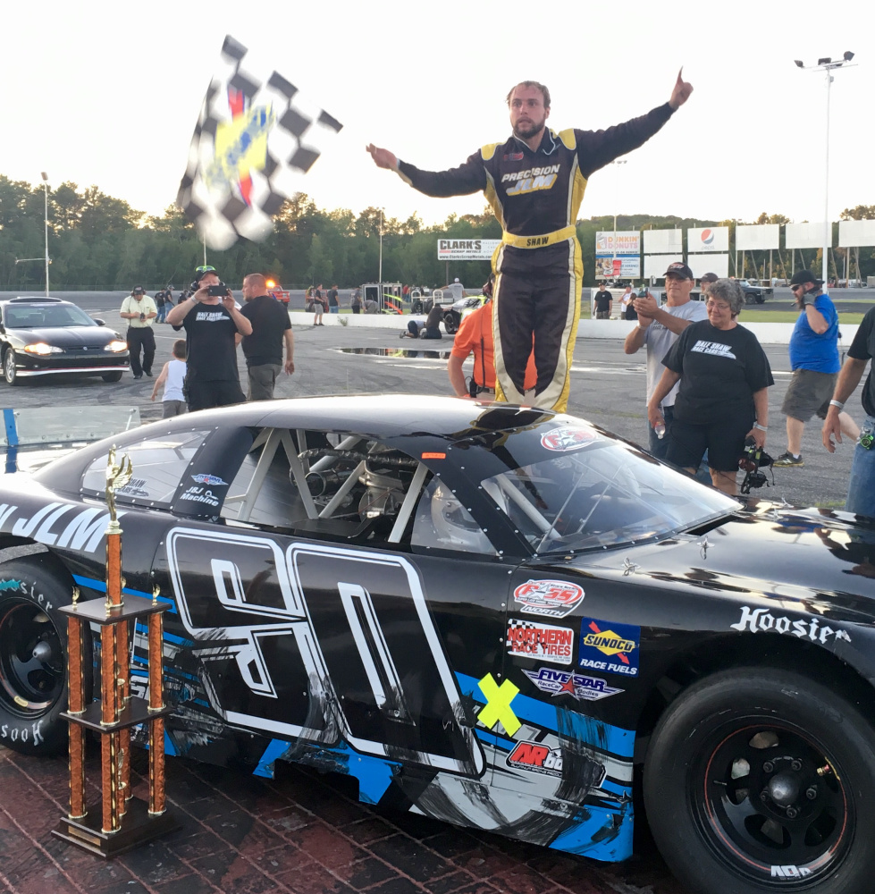 D.J. Shaw of Center Conway, New Hampshire, celebrates after winning the PASS Open 100 on Sunday at Oxford Plains Speedway.