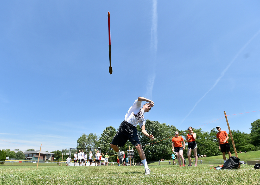 Trey Goodwin, 14, of Winslow, competes in the javelin during a youth summer track meet Thursday at Winslow High School.