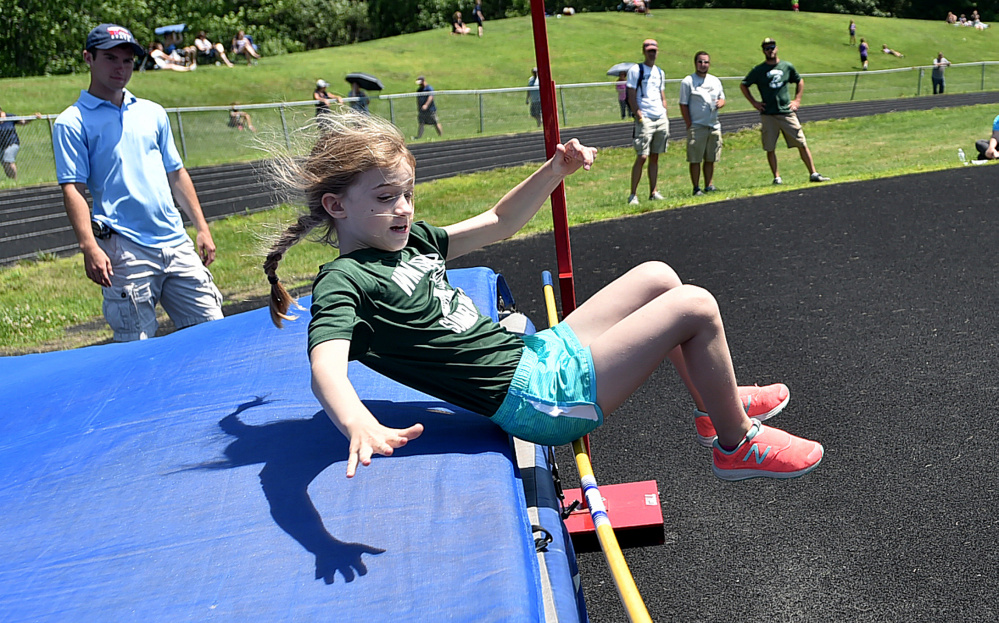 Winthrop's Gwen Lewis competes in the high jump during a youth summer track meet Thursday at Winslow High School.