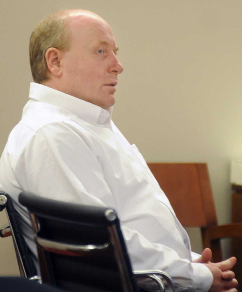 Roland L. Cummings listens Nov. 18, 2015, during his trial in Augusta as state prosecutors summarize their case against him for the murder of 92-year-old Aurele Fecteau in Waterville.