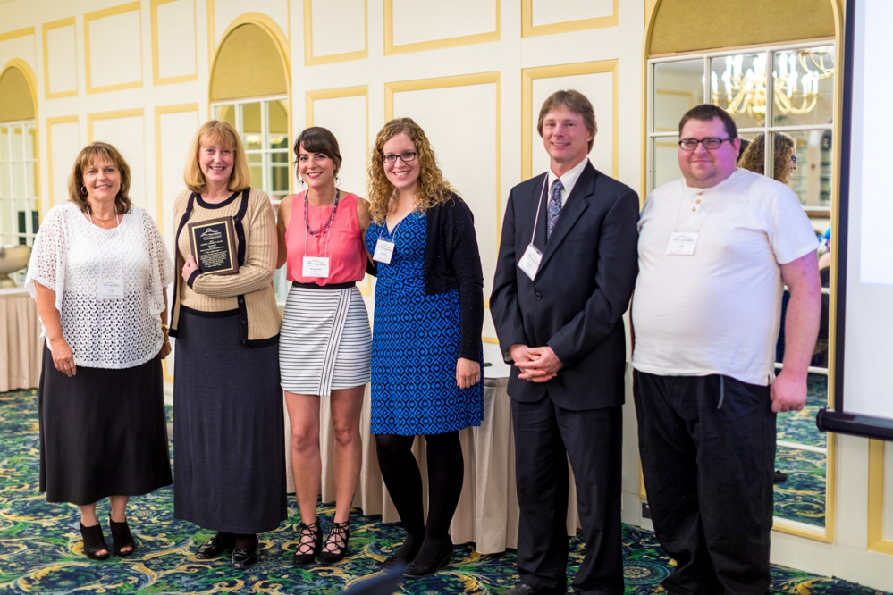 James R. Schmidt Award Winner Lisa Smith and Humane Society Waterville Area. From left are Lisa Soucie, Lisa Smith, Maggie Bryant, Morgan Place, Darryl Bowles and Josh Fates.