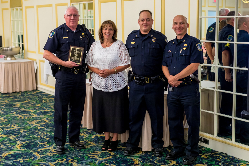 Outstanding Community Partnership Award Winner Waterville Police Department. From left are Chief Joseph Massey, Lisa Soucie, Sgt. Dan Goss and Deputy Chief William Bonney.