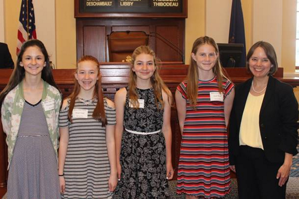 Winthrop Middle School students, from left, are Pheobe Dow, Aleah Child, Julia Letorneau and Josie Nuce with Sen. Shenna Bellows.