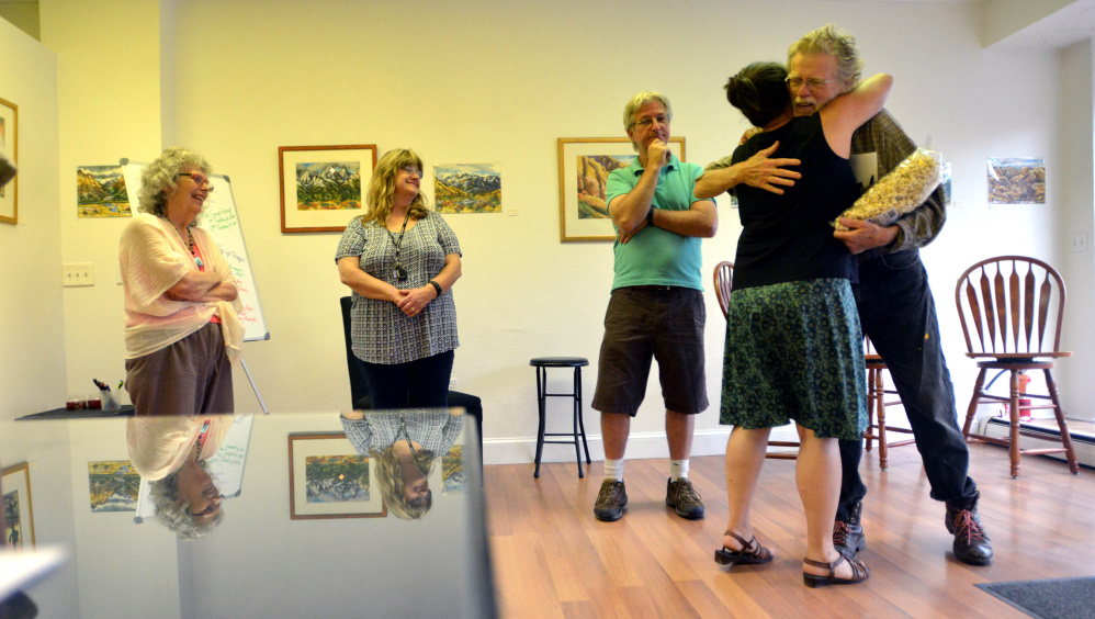 People gather at Skowhegan's newest art venue, Fourteen Madison, on Wednesday to plan for Wesserunsett Arts Council's annual Open Studio Tour, which will be held Aug. 12 this year, and not in October as in previous years.