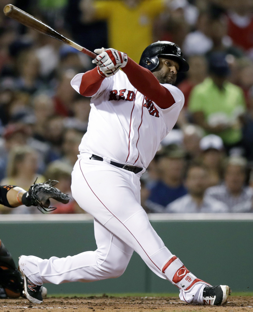 In this April 11 photo, Boston third baseman Pablo Sandoval swings during the second inning against the Orioles at Fenway Park in Boston.