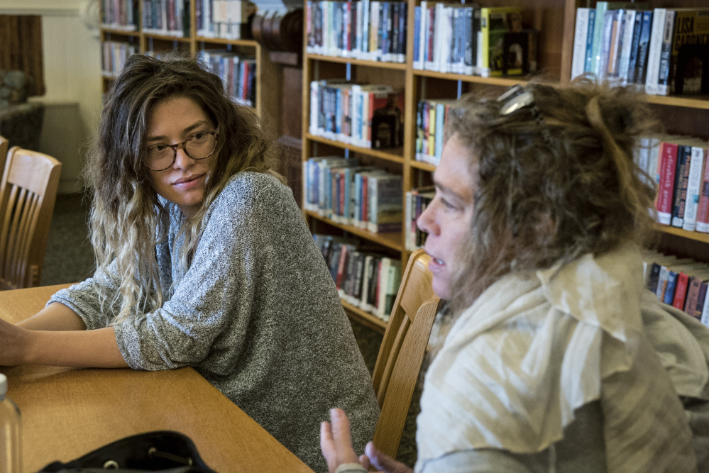 Lana Smithner, left and her mother, Denise Rohdin, both of Waterville, discuss their interest in LumenARRT! at a workshop Saturday at the Waterville Public Library. The activist artistry projected on buildings was on display at the opening night of the Maine International Film Festival.