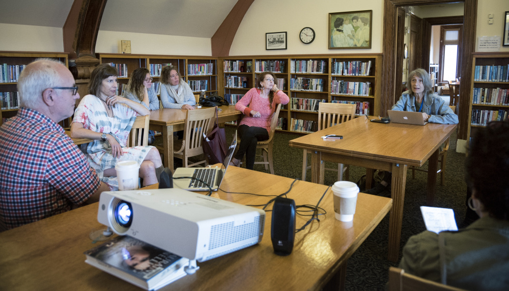 Community members and visitors who were in Waterville for the Maine International Film Festival attend a Saturday workshop at the Waterville Public Library on activist project art known as LumenARRT!.