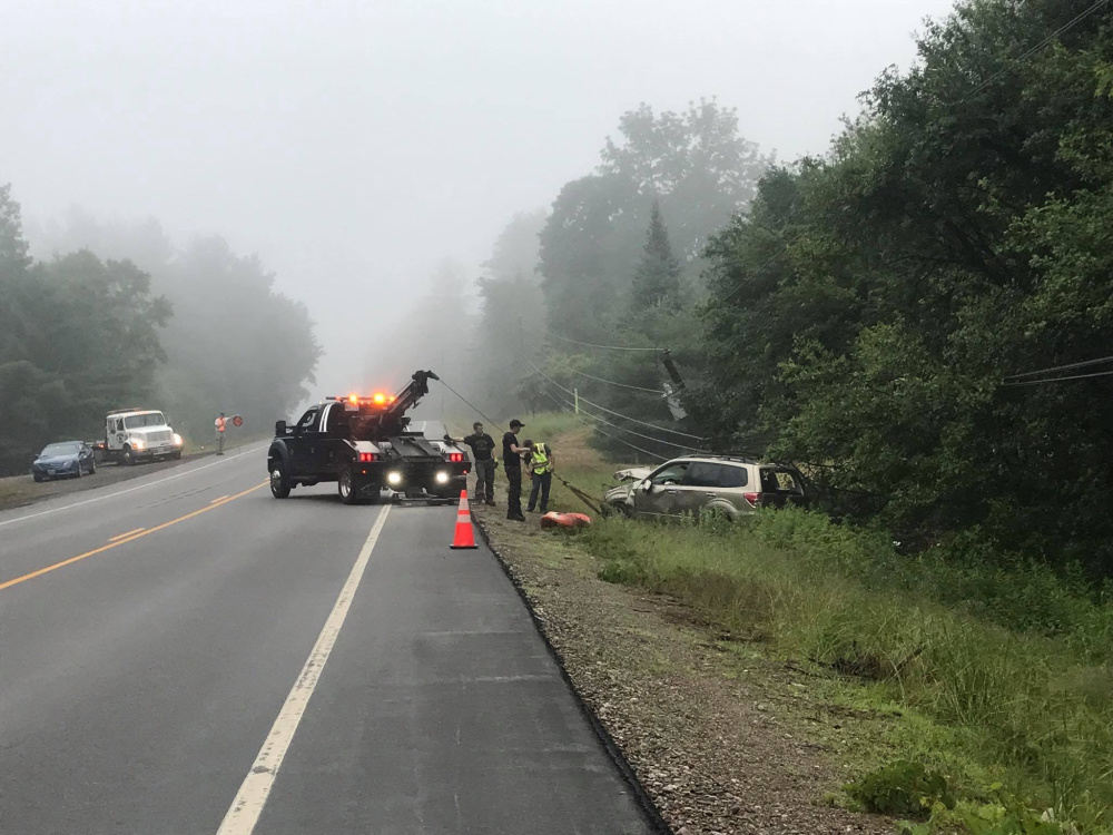 A 2009 Subaru Forester that crashed on Monday into a ditch along U.S. Route 201 in The Forks, breaking a utility pole, is towed. The driver, Jay Borden of New Hampshire, has been charged with operating under the influence.