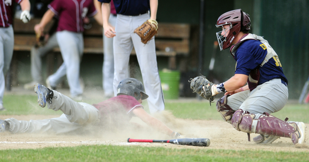 Franklin baserunner Tom Wing slides safely into home to tie a Zone 2 playoff game with Augusta at 2-2 in 4th inning at Morton Field in Augusta.