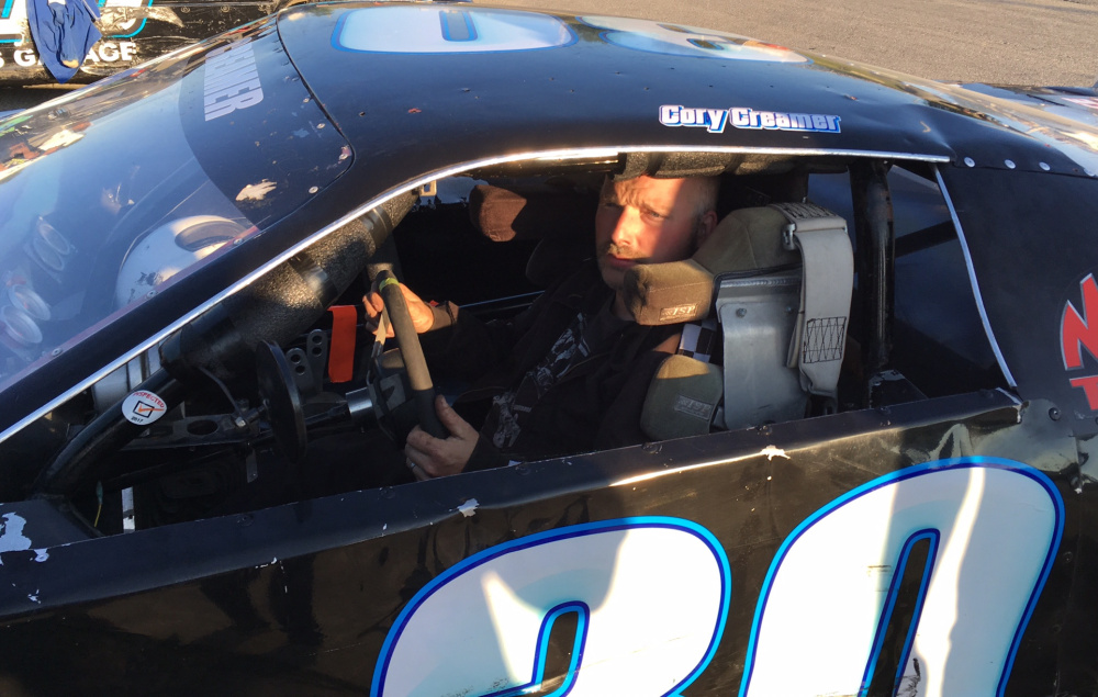 Cory Creamer of Randolph climbs into his car prior to a Super Street division feature race at Wiscasset Speedway last Saturday.