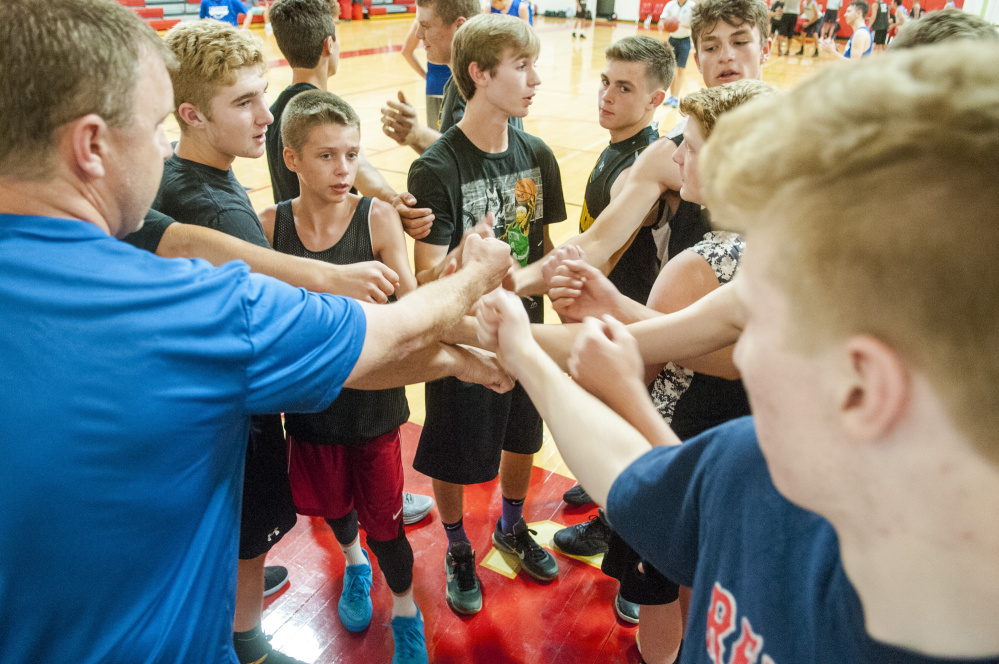 The Maranacook team huddles before a summer league game against Lawrence on Wednesday at Cony High School in Augusta.