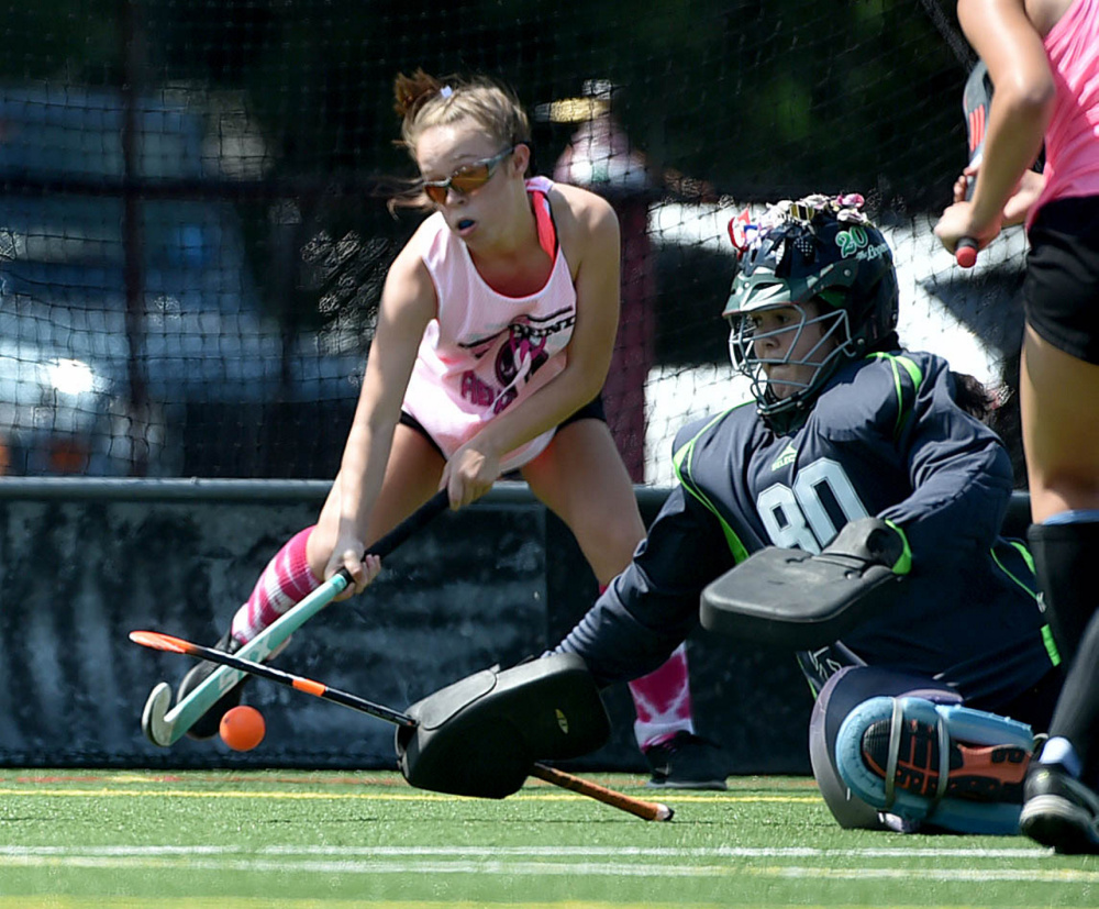 Staff photo by Michael G. Seamans   Spruce Mountain goalie Melissa Bamford (80) tries to make a save on a Skowhegan goal during the 7th annual Battle for Breast Cancer field hockey tournament Saturday at Thomas College in Waterville.