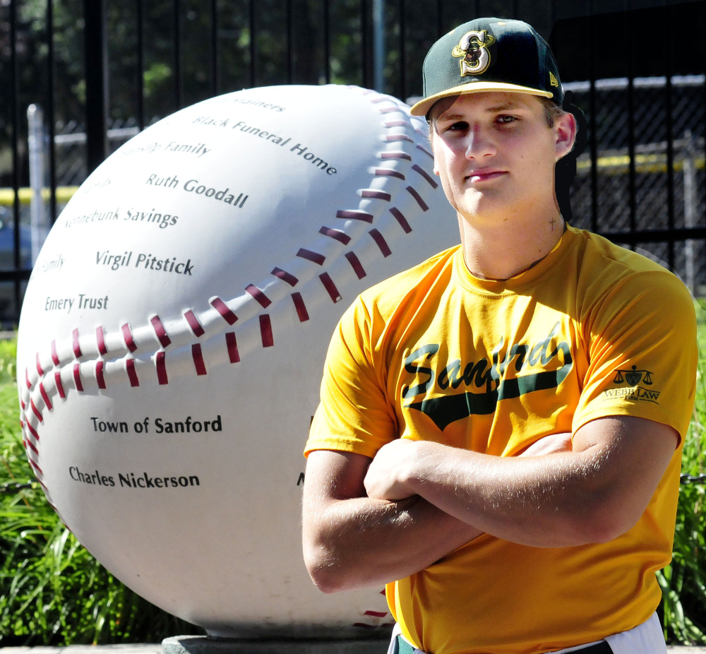 Former Messalonskee star Jake Dexter poses in front of Goodall Park in Sanford prior to a game Wednesday. Dexter plays for the Sanford Mainers in the New England Collegiate Baseball League.
