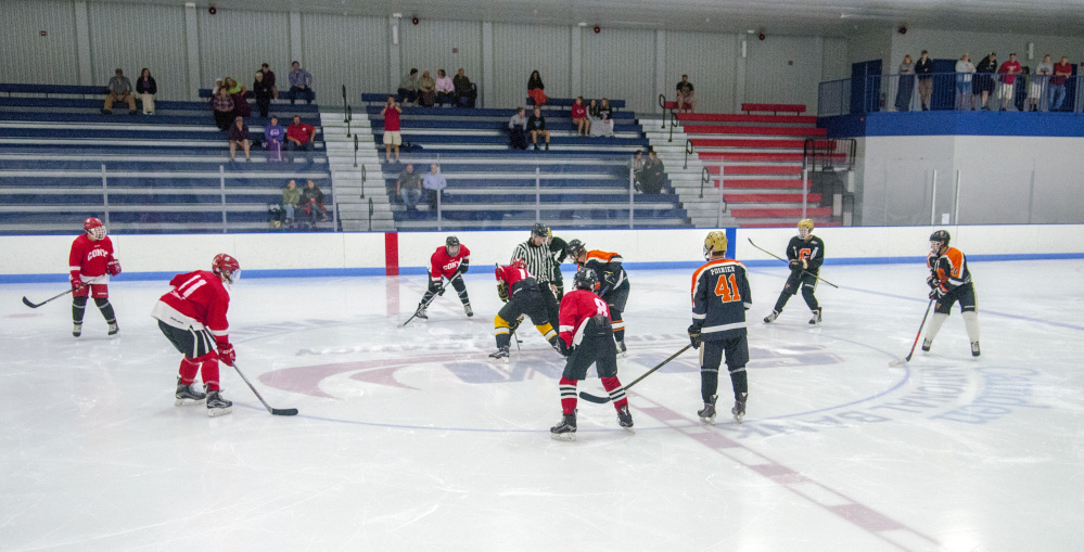 A small crowd watches the opening face off of a Gardiner vs. Cony summer league game Friday at the Camden National Bank Ice Vault in Hallowell.