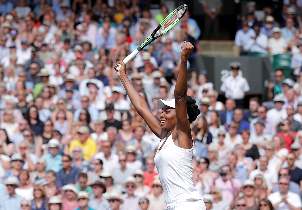 Venus Williams celebrates winning the semifinal match against Great Britain's Johanna Konta.