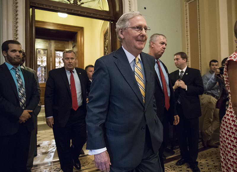 Senate Majority Leader Mitch McConnell of Ky. leaves the Senate chamber on Thursday, after announcing the revised version of the Republican health care bill.