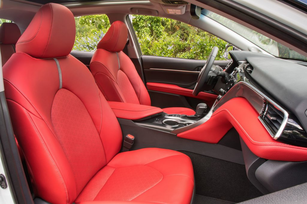 The 2018 Toyota Camry is two inches longer and less than one inch wider than the Camry it replaces, and passengers sit about one inch lower than last year.