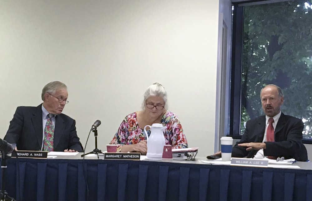 AUGUSTA, MAINE-August 10: Maine Ethics Commissioners Richard Nass, left and Margaret Matheson, center, listen as Commissioner William Lee, III, at right, discusses the commission's investigation into the finances of a ballot question campaign aimed at bringing a casino to York County Thursday at the commission's headquarters in Augusta. (Staff Photo by Scott Thistle/Staff Writer)