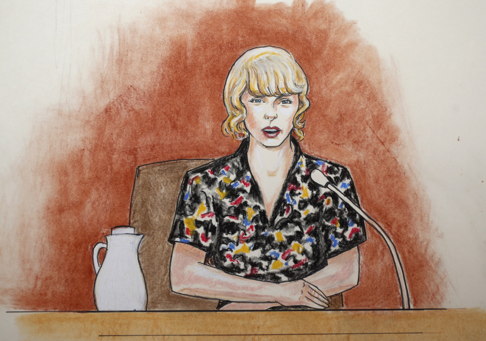 In this courtroom sketch, pop singer Taylor Swift speaks from the witness stand Thursday in Denver.