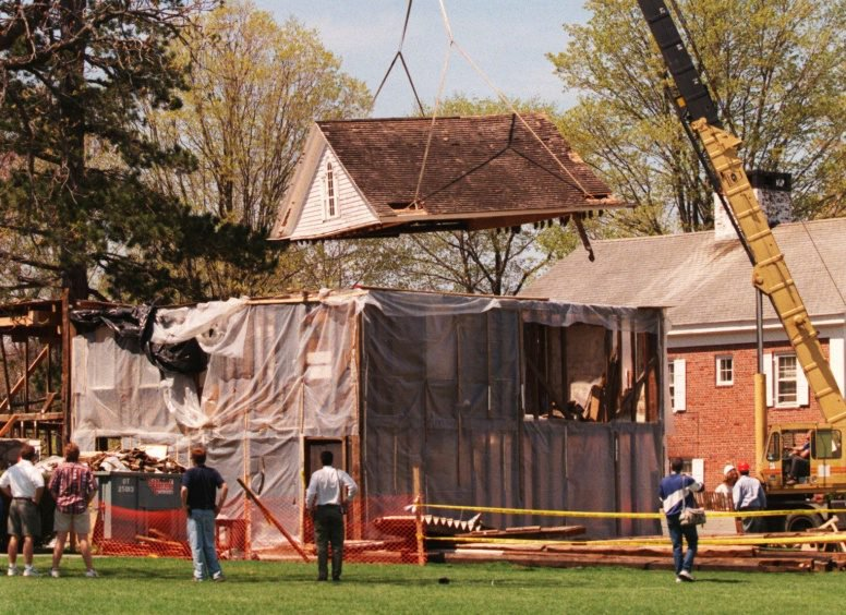 The attic of the home of the late Lyman Beecher is lifted off its Colonial post-and-beam structure in Litchfield, Conn., in 1998. Stored in pieces, the house where Harriet Beecher Stowe grew up is for sale on eBay.