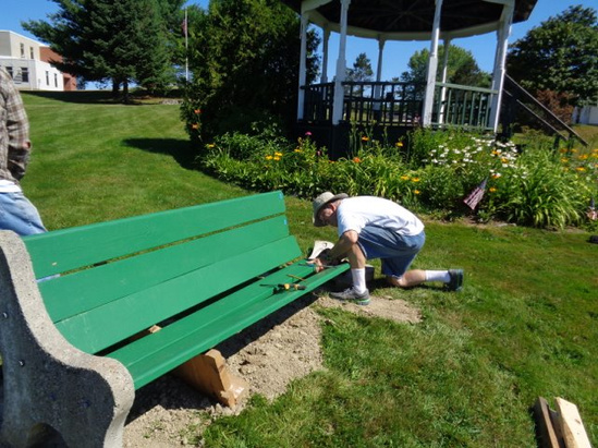Volunteer David Holden gets ready to set the bolts into the new boards he prepared for the benches on the property surrounding the bandstand and the Veterans Memorial in Jefferson. Holden did all the prep and paint work on the boards and the new supports for the benches. Marilyn and Ron Speckmann assisted with the final fitting into the side supports. The gardens around the bandstand, seen in the background, and those on the Veterans Memorial site have been cared for by a small, but dedicated group of volunteers. For more information or to volunteer, call 549-5258.