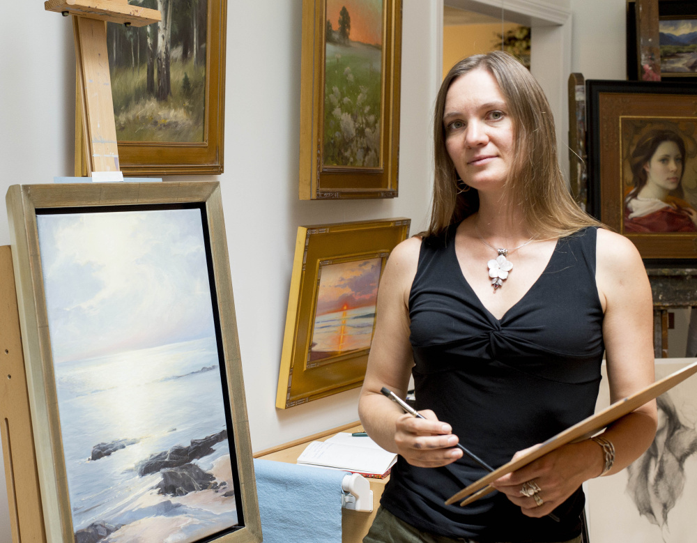 Olena Babak, a native of Ukraine and a Hartland artist, stands in her studio Saturday as she takes part in the Wesserunsett Arts Council's Open Studio Tour.