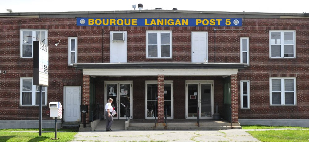 A woman enters the American Legion hall, Bourque-Lanigan Post 5 in Waterville on Monday. The Post says it is selling the building to the Augusta-based Children's Discovery Museum.