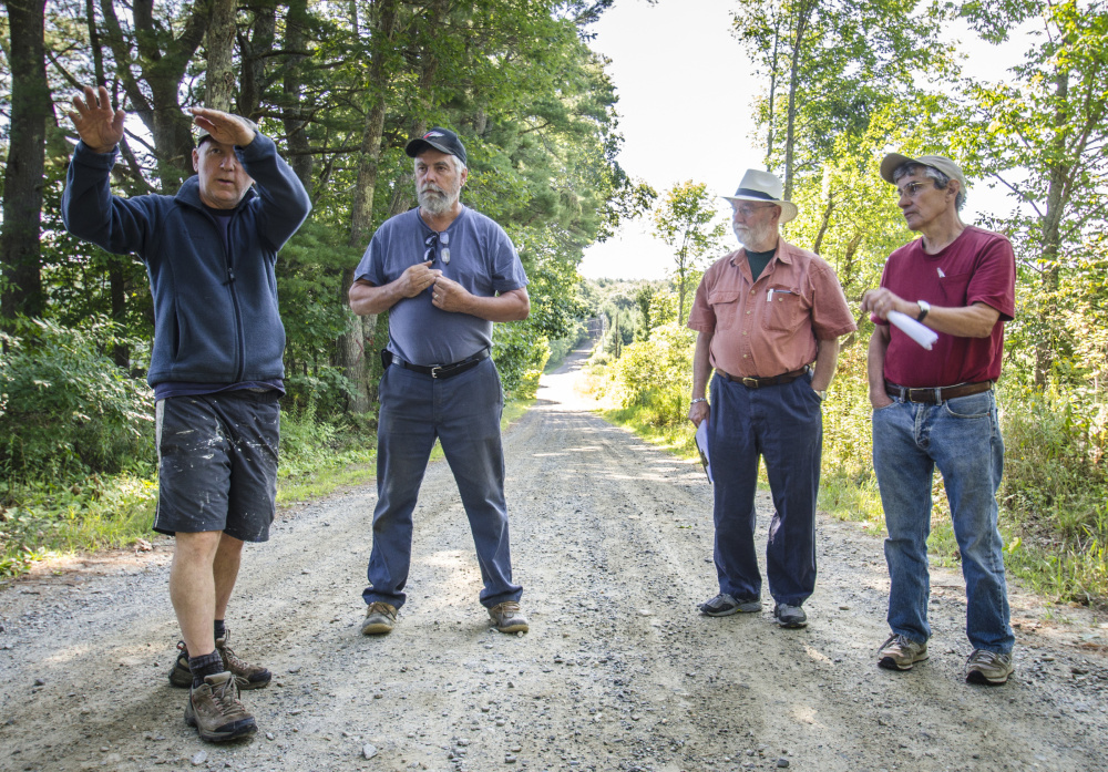 Whitefield town officials and residents gathered Monday on Hollywood Boulevard to discuss the removal of trees to enhance road safety and improve drainage. Left to right are: Chris Hamilton, who lives on the road, Road Commissioner David Boynton, and Selectmen Frank Ober and Tony Marple.