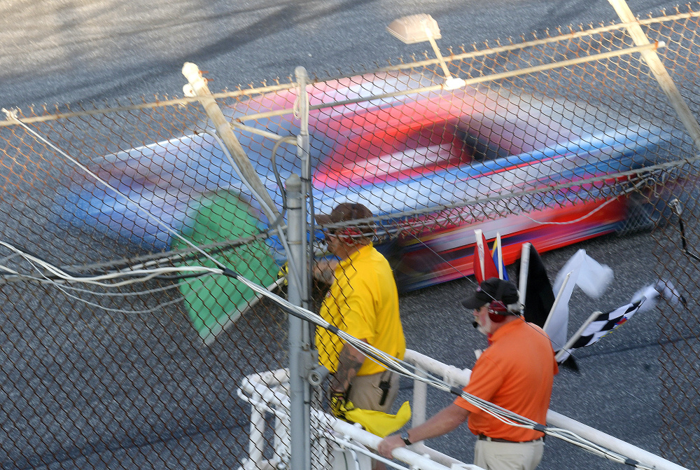The green flag is dropped at the beginning of the Oxford 250 on Sunday at Oxford Plains Speedway.