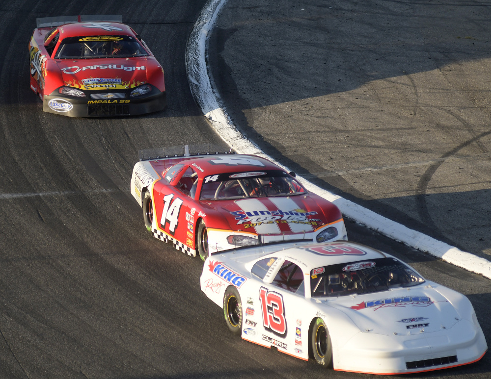 Cassius Clark, right, leads the pack during the Oxford 250 on Sunday at Oxford Plains Speedway.