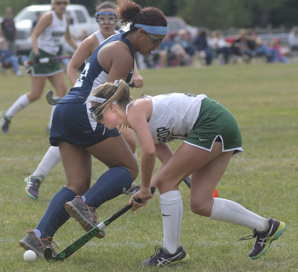 Winthrop's Katie Perkins, right, drives past Dirigo defender Grace Timberlake during a field hockey game Wednesday in Winthrop. The Ramblers won, 2-1.
