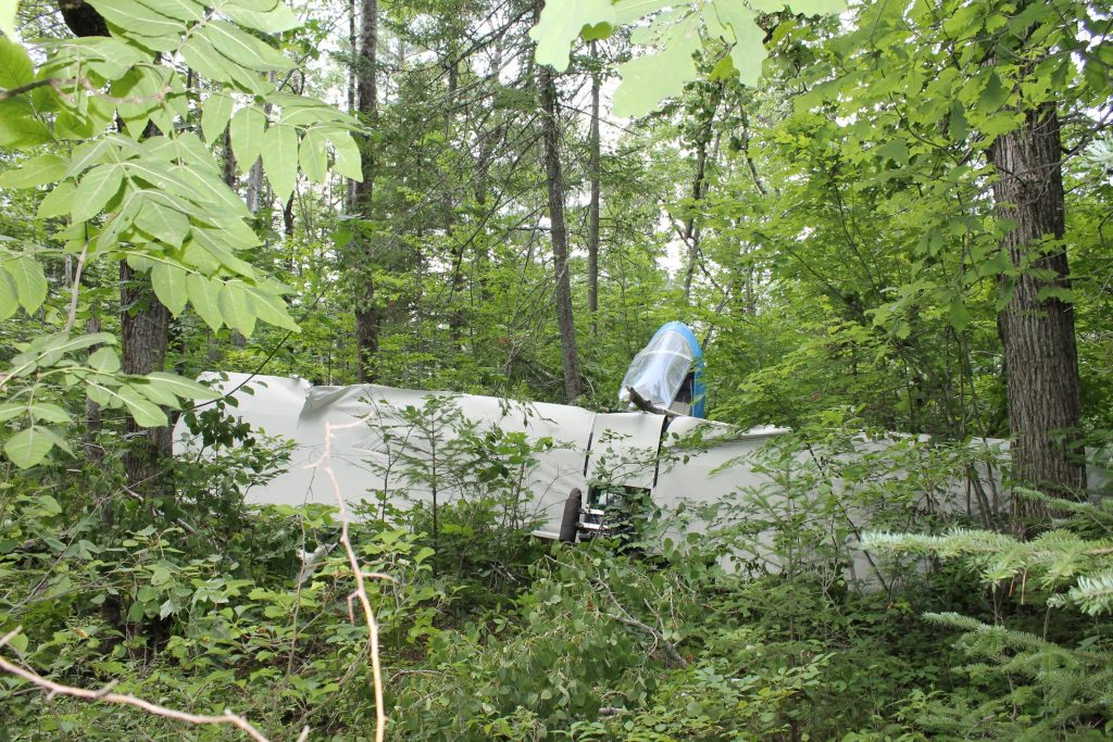 Bill Fuller, 75, of Clinton walked away from the wreckage of an ultralight plane that crashed Tuesday morning in the woods off Neck Road in Benton Tuesday morning.  Fuller suffered minor injuries from the crash.