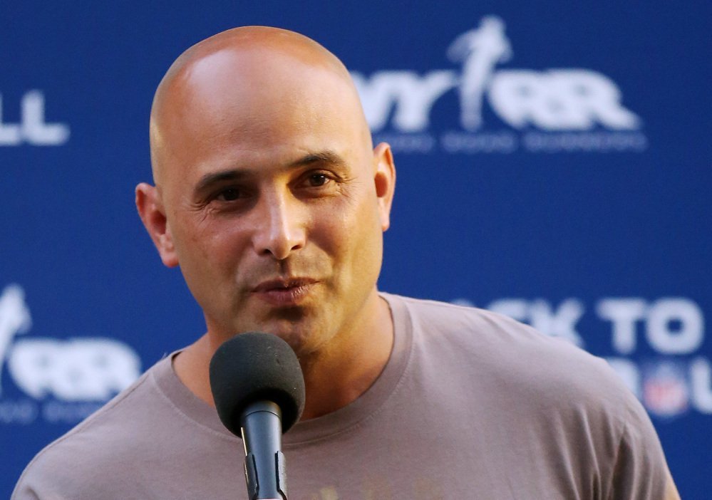 Craig Carton, who hosted a radio show with former NFL quarterback Boomer Esiason, has been charged with fraud.