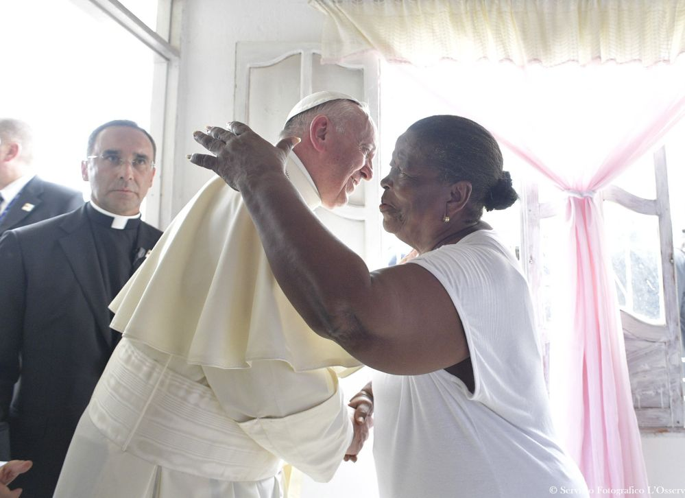 Lorenza Perez greets Pope Francis as he visits her home Sunday in Cartagena on the last day of his trip to Colombia.