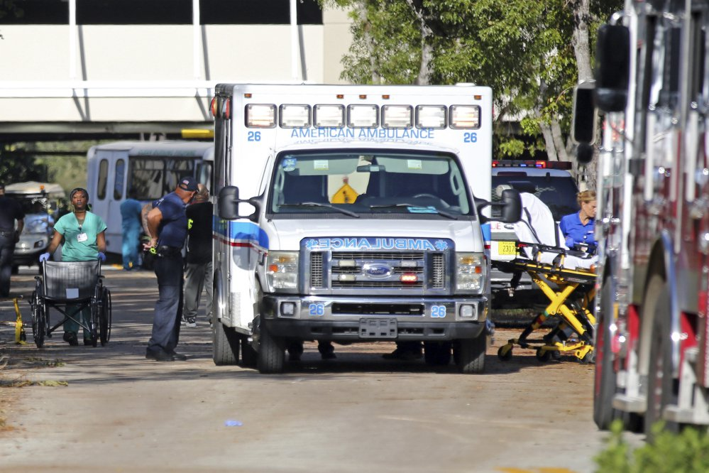 Patients are evacuated Wednesday from the Rehabilitation Center at Hollywood Hills, where eight patients died after Hurricane Irma knocked out the air conditioning.