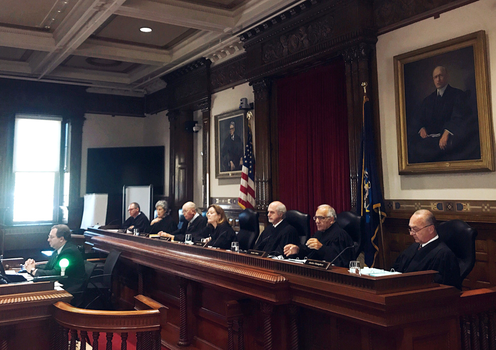 The Maine Supreme Judicial Court hears arguments Wednesday on whether an employer in Maine, where medical marijuana is legal, must reimburse an injured worker for a drug that is illegal under U.S. law.