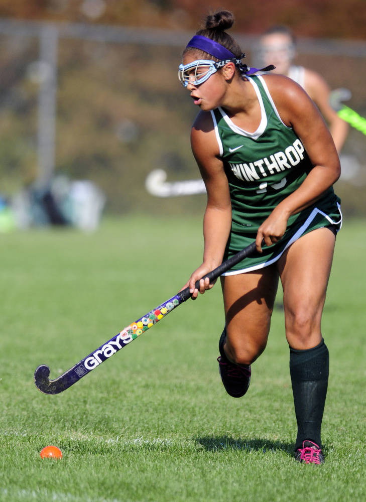 Winthrop's Breonna Feeney moves down field during a game Monday against Oak Hill in Litchfield.